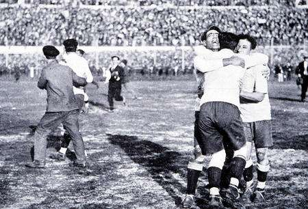 World Cup Final, 1930. Montevideo, Uruguay. Uruguay 4 v Argentina 2. Members of the the Uruguayan team celebrate after Winning the Jules Rimet trophy by beating rivals Argentina in the first ever World Cup Final .